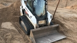 Аренда мини-погрузчика Bobcat Т590 болотный
